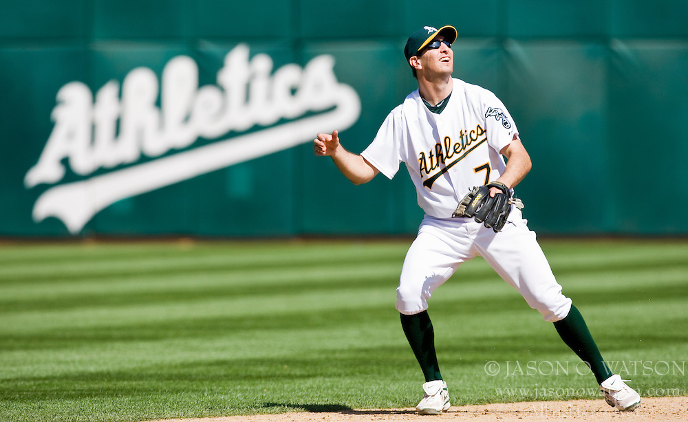 April 18, 2010; Oakland, CA, USA;  Oakland Athletics third baseman Adam Rosales (7) watches a two run home run off the bat of Baltimore Orioles second baseman Ty Wigginton (not pictured) during the ninth inning at Oakland-Alameda County Coliseum. Baltimore defeated Oakland 8-3.