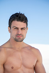 hot shirtless man with green eyes and black hair outdoors