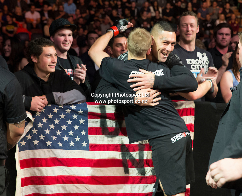 Kiwi Dan Hooker celebrates his win over Ian Enwistle with fans ringside during the UFC Ultimate Fighting Championship fight night held at Vector Arena in Auckland on Saturday 28th of July 2014. <br /> Credit; Peter Meecham/ www.photosport.co.nz