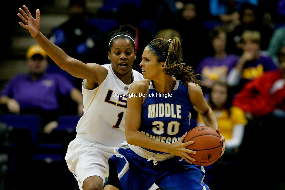 Nov 18, 2009; Baton Rouge, LA, USA; Middle Tennessee Blue Raiders guard Anna Marie Lanning (30) is defended by LSU Lady Tigers guard Katherine Graham (1) during the first half at the Pete Maravich Assembly Center. LSU defeated Middle Tennessee 61-40.  Mandatory Credit: Derick E. Hingle-US PRESSWIRE