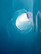 looking outside from within of an ice cave in Franz Josef Glacier, New Zealand