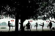 Locals are practicing Tai-chi early in the morning on the banks of the Pearl River of Shamian Island.