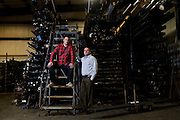 BELLEVILLE, WI-MAY 19, 2016: Former NSA hackers and Area 1 founders Oren Falkowitz, left, and Blake Darche, right, sit for a portrait inside Cate Machine and Welding Thursday, May 19, 2016. Cate Machine and Welding, a business in Belleville, WI, is among companies nationwide whose computer servers have been compromised by Chinese hackers. The hackers funnel their attacks through these servers to breach high profile targets. Cate Machine and Welding has allowed Area 1, a cyber sleuth company, to monitor the activity on their servers in order to alert potential victims of an attack. Lauren Justice for The New York Times
