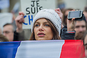 Manon Meignen shows her support. Je suis Charlie/I am Charlie - A largely silent (with the occasional rendition of the Marseilaise)gathering in solidarity with the march in Paris today.  Trafalgar Square, London, UK 11 Jan 2015
