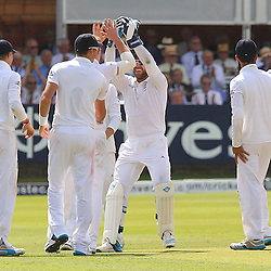 England players celebrate the wicket of India's Cheteshwar Pujara during the first day of the Investec 2nd Test match between England and India at Lords, London, 17th July 2014 © Phil Duncan | SportPix.org.uk