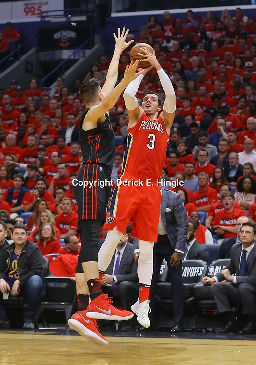 Apr 19, 2018; New Orleans, LA, USA; New Orleans Pelicans forward Nikola Mirotic (3) shoots over Portland Trail Blazers center Jusuf Nurkic (27) during the first quarter in game three of the first round of the 2018 NBA Playoffs at the Smoothie King Center. Mandatory Credit: Derick E. Hingle-USA TODAY Sports