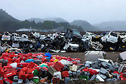 Piles of destroyed cars and plastic containers that were collected while cleaning Taro village from the rouble, after it was destroyed by the March 11 earthquake and tsunami. Iwate prefecture, Japan.