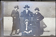 three young adult woman and one man casually 1900s