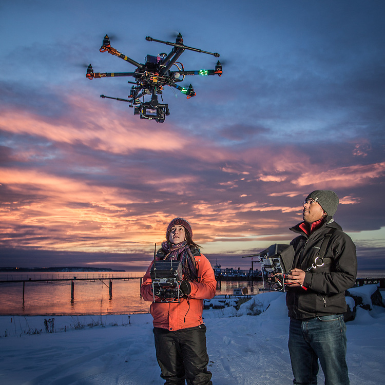 Hailey Driver of Sky Picture Films operates a remote camera suspended below a remote control helicopter controled by Thomas Mace at the small boat launch near Ship Creek, Anchorage        h.driver907@gmail.com