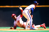CINCINNATI-CIRCA 1989:  Barry Larkin of the Cincinnati Reds slides safely into second base during an MLB game at Riverfront Stadium in Cincinnati, Ohio.  Larkin played for the Reds from 1986-2004.   (Photo by Ron Vesely)   Subject: Barry Larkin.