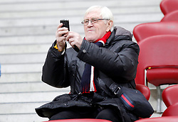 05.03.2014, Kazimierz Gorski Stadium, Warschau, POL, Testspiel, Polen vs Schottland, im Bild JACEK GMOCH TELEFON // JACEK GMOCH TELEFON during the International Friendly match between Poland and Scotland at the Kazimierz Gorski Stadium in Warschau, Poland on 2014/03/05. EXPA Pictures © 2014, PhotoCredit: EXPA/ Newspix/ MICHAL CHWIEDUK<br /> <br /> *****ATTENTION - for AUT, SLO, CRO, SRB, BIH, MAZ, TUR, SUI, SWE only*****