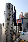 ZHENGZHOU, CHINA - China Out - Finland Out<br /> <br /> 33-Storey Food Steamer<br /> <br /> People pile up 33 storeys of food steamers  in Zhengzhou, Henan Province of China. The 4-meter-tall food steamer tower takes 40 minutes for steaming over 1,000 steamed breads which are made of 100 kg wheat flour.<br /> ©Exclusivepix