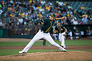 Oakland Athletics starting pitcher Sean Manaea (55) pitches against the San Francisco Giants at Oakland Coliseum in Oakland, California, on August 1, 2017. (Stan Olszewski/Special to S.F. Examiner)