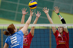 Tjasa Turnsek pokes ball over block during volleyball match between Calcit Volleyball and A. Linz-Steg in Mevza league on October 23, 2010 at Sport Halli, Kamnik, Slovenia. (Photo By Matic Klansek Velej / Sportida.com)