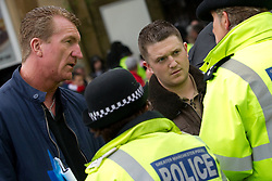 © Licensed to London News Pictures . FILE PICTURE DATED 09/06/2012 . The EDL leader , STEPHEN YAXLEY-LENNON ( aka TOMMY ROBINSON ) (right) ( pictured at a demonstration in Rochdale ) has announced he intends to turn the EDL in to a political party after quitting as a Vice Chairman of the British Freedom Party . The EDL's deputy leader , KEVIN CARROLL (left), remains a Vice Chairman of the British Freedom Party and is to stand in the upcoming Police and Crime Commissioner election , in Bedfordshire . Photo credit : Joel Goodman/LNP
