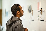 Torin Jacobs, senior, bids on student artwork at the 6th Annual Art Extravaganza in the McCracken Hall Gallery on Monday, November 5, 2012. The auction will provide money necessary to buy a kiln for the class.