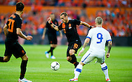 In action for    Wesley Sneijder The Netherlands versus  Miroslav Stoch    Slovakia during friendly soccer match between Netherlands vs Slovakia in Rotterdam on May 30, 2012. AFP PHOTO/ ROBIN UTRECHT