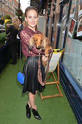 ROSIE FORTESCUE and her dog Noodles at A Date With Your Dog At George in aid of the Dogs Trust held at George, 87-88 Mount Street, London on 9th September 2014.