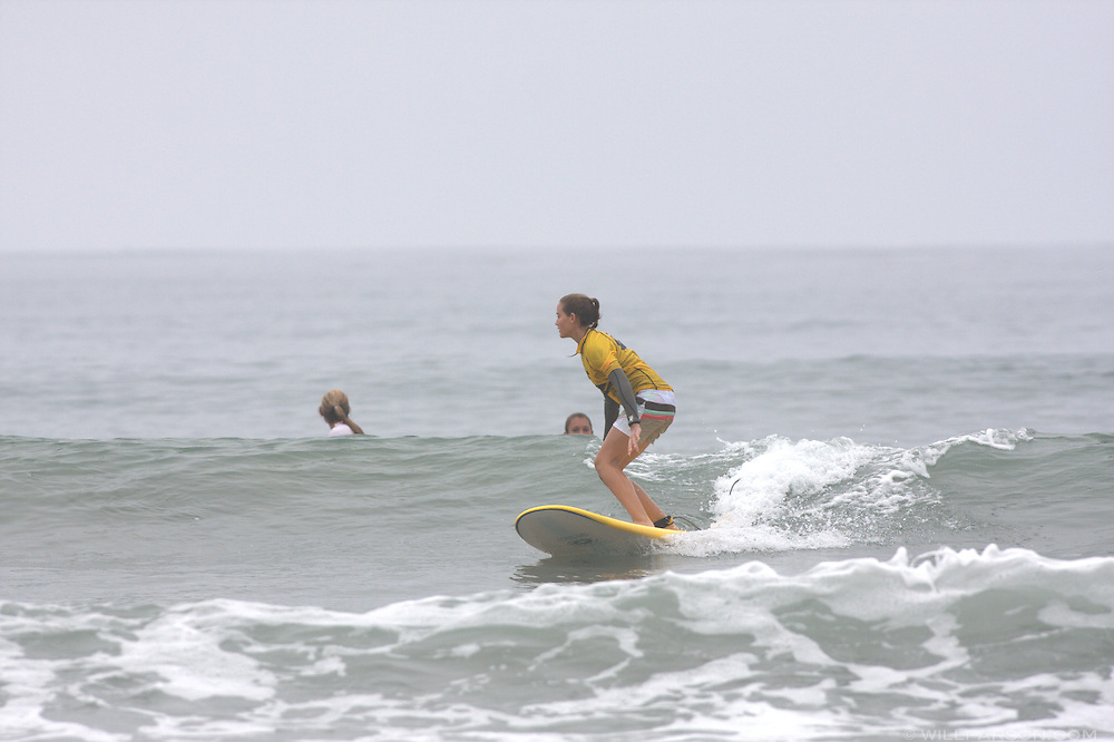 Kiernan Panish catches a wave during the girls' age 14-17 portion of the first annual Grom-o-rama youth surf tournament in Solana Beach, California on August 23, 2008.  Panish placed fourth in the event.