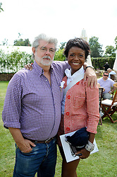 GEORGE LUCAS and MELLODY HOBSON at a luncheon hosted by Cartier for their sponsorship of the Style et Luxe part of the Goodwood Festival of Speed at Goodwood House, West Sussex on 4th July 2010.