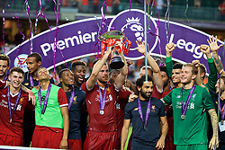 HONG KONG, CHINA - Saturday, July 22, 2017: Liverpool's captain Jordan Henderson lifts the trophy after beating Leicester City 2-1 during the Premier League Asia Trophy final match between Liverpool and Leicester City at the Hong Kong International Stadium. (Pic by David Rawcliffe/Propaganda)