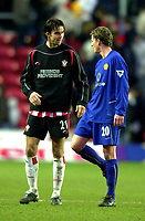Photo. Richard Lane. <br /> Southampton v Manchester United. Barclaycard Premiership. 01/02/2003<br /> Jo Tessem ans Ole Gunnar Solskjaer chat as they leave the field.