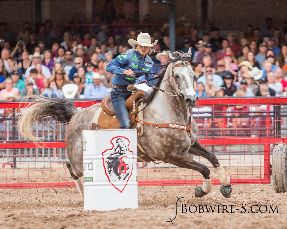 Stevi Hillman of Weatherford, Texas, makes her run in the second go of Cheyenne Frontier Days on Saturday, July 29, 2017. Hillman, who won the first go with a 17.48, made her run in 17.63, which was good enough for eighth place in the second go, and she was leading the average with a 35.11 going into the finals on Sunday.