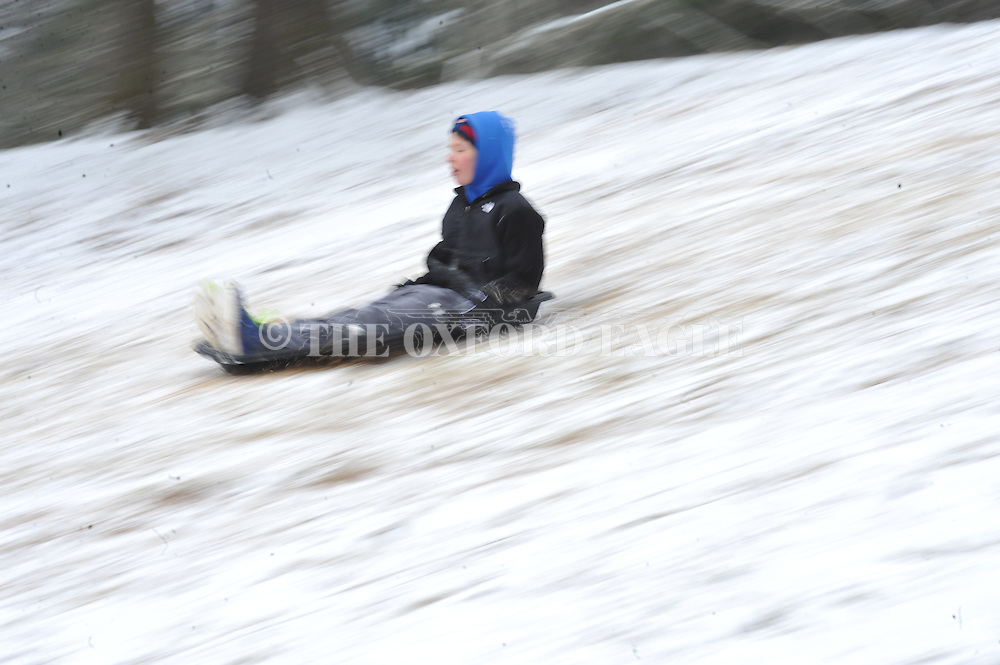 Nate Leary rides a sled at Avent Park,  in Oxford, Miss. on Tuesday, February 11, 2014. A thin layer of ice covered by snow has closed area schools.