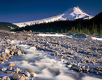 Mount Hood 11,249 feet (3,429 m) and White River near it's origin on the White River Glacier, Oregon USA