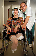 Fikreta Hadovic, 24, who lost both her legs to a Bosnian Serb shell, poses for a photograph with Dr. Edib Jaganjac at French Hospital in Sarajevo, August 1992. (Photo by Roger Richards)