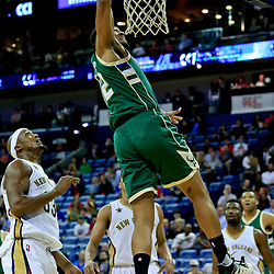 Nov 1, 2016; New Orleans, LA, USA; Milwaukee Bucks forward Jabari Parker (12) dunks over New Orleans Pelicans forward Dante Cunningham (33) during the first quarter of a game at the Smoothie King Center. Mandatory Credit: Derick E. Hingle-USA TODAY Sports