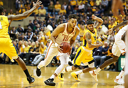 Jan 20, 2018; Morgantown, WV, USA; Texas Longhorns guard Eric Davis Jr. (10) drives and shoots during the first half against the West Virginia Mountaineers at WVU Coliseum. Mandatory Credit: Ben Queen-USA TODAY Sports