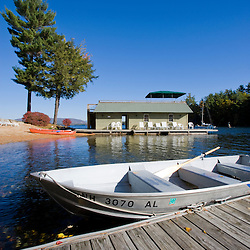 A skiff and the boathouse at Oliver Lodge on Lake Winnipesauke in Meredith, New Hampshire.
