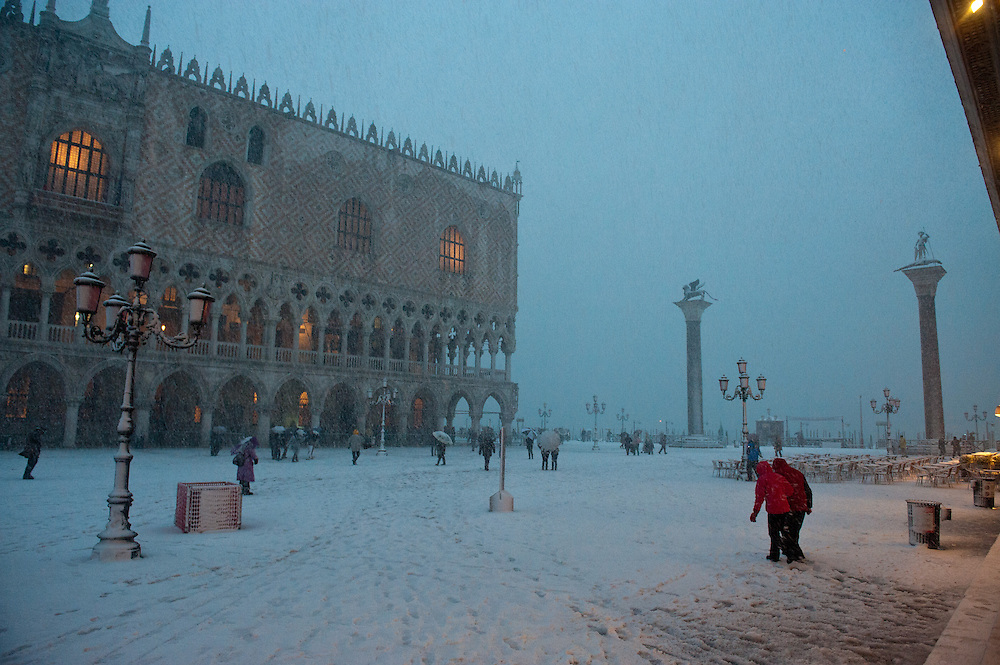 As Venice's annual Carnival celebration comes to a close, the city has been flooded by Acqua Alta and melting snow. The coincidence of the 15th highest tide in the history of the city and a heavy snowfall has left travelers and locals alike a little bit chilly and damp even as it accomplished the impossible, making Europe's most romantic city even more photogenic...The Piazza San Marco looked like the North Sea Monday as crews hustled to bring chairs and bandstands inside. Masks and waders quickly became the styles du jour as revelers refused to have their good time dampened.