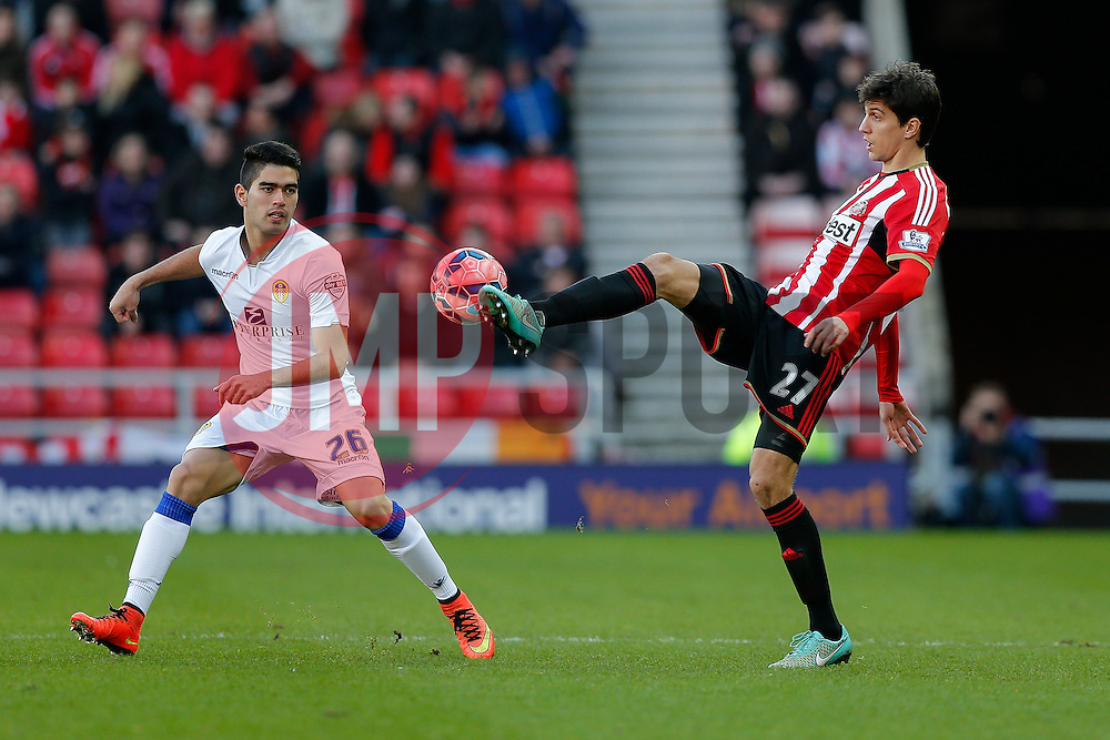 Santiago Vergini of Sunderland is challenged by Brian Montenegro of Leeds United - Photo mandatory by-line: Rogan Thomson/JMP - 07966 386802 - 04/01/2015 - SPORT - FOOTBALL - Sunderland, England - Stadium of Light - Sunderland v Leeds United - FA Cup Third Round Proper.