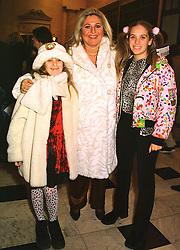 TV presenter VANESSA FELTZ and her children left, ALLEGRA and right, SASKIA at a reception in London on 6th December 1998.MMP 17