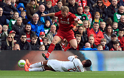 Liverpool's Dirk Kuyt jumps the tackle from Milan's Serginho during the Legends match at Anfield Stadium, Liverpool.