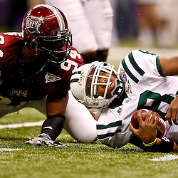 December 18, 2010; New Orleans, LA, USA; Troy Trojans defensive end Jonathan Massaquoi (94) sacks Ohio Bobcats quarterback Boo Jackson (8) during the 2010 New Orleans Bowl at the Louisiana Superdome. Troy defeated Ohio 48-21. Mandatory Credit: Derick E. Hingle