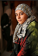 Salwa Raza, 18, is a high school student in Miami Lakes who decided to wear a head scarf when she was in the seventh grade --- wearing the scarf leaves her open to stares, and looks from strangers, and in the wake of the chapel hill incident, Muslim women like her are becoming more cautious when it comes to going out covered. This is Salwa at her home in Miami Lakes on Friday, February 20, 2015.