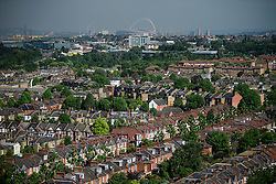 © Licensed to London News Pictures. 14/06/2017. London, UK. A view over the rooftops of west London showing Wembley Stadium in the distance. Photo credit: Ben Cawthra/LNP