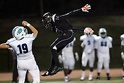 Erie Cathedral Prep Ramblers defensive back Jaelen Carson (14) leaps while attempting to block a punt during the 2017 high school football game against the against the Cleveland Benedictine Bengals, Friday, Sept. 15, 2017 in Erie, Pa. The Ramblers won the game 62-28. (©Paul Anthony Spinelli)