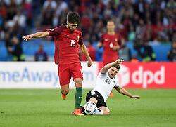 Andre Gomes of Portugal evades the challenge of Marcel Sabitzer of Austria  - Mandatory by-line: Joe Meredith/JMP - 18/06/2016 - FOOTBALL - Parc des Princes - Paris, France - Portugal v Austria - UEFA European Championship Group F