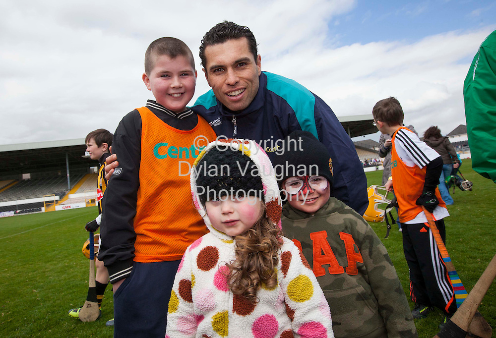 28/4/2012.no charge for media repro...PHOTO CAPTION..CENTRA BRIGHTENS UP THE DAY IN NOWLAN PARK.. Centra Brighten Up Your Day Community Event Visits Nowlan Park with Henry Shefflin and Sean Og O hAilpin..Saturday 28th April, Nowlan Park:  Sean Og O hAilpin with Zack, Carla and Josh O'Connor pictured at the Centra Brighten Up Your Day Community Event at Nowlan Park on Saturday 28th April.  The free family event featured two of Centra's GAA Hurling Ambassadors, Henry Shefflin (Kilkenny) and Sean Og O hAilpin (Cork) who both hosted a hurling skills session for children.  In addition, there was some cracking family fun including face painting, a hurling skills simulator and a delicious BBQ by local Centra retailers, Nolans Centra (Ardnore), Deegans Centra (Urlingford), Carrolls Centra (Knocktopher), Hennessys Centra (Johns Green)...Centra, Irelands largest convenience retailer who is in its third year as sponsor of the GAA Hurling All Ireland Championship will be spreading the GAA message with top inter-county players across local communities throughout Ireland with their Centra Brighten Up Your Day Community Events in 2012 from Saturday April 21st to Saturday July 28th.  All events are free; to register email centragaa@centra.ie or Freetext CENTRA followed by the county of the event you would like to attend and your name to 50050. ..For more information log onto www.centra.ie or Facebook.com/centraireland..Ends.For further information, please contact:.Sarah Brewer and Eilis Smith, BespokewithDirection.Tel: 01 6651950 Mobiles: 086 8238229 /087 7604954.Email: sarah.brewer@bespokewithdirection.ie /eilis.smith@bespokewithdirection.ie.