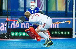 England's Ashley Jackson gets a shot away towards Jaap Stockmann. England v Netherlands  - Unibet EuroHockey Championships, Lee Valley Hockey & Tennis Centre, London, UK on 23 August 2015. Photo: Simon Parker
