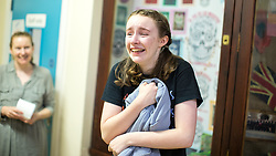 © Licensed to London News Pictures . 24/08/2017 . Rochdale , UK . EMILY CAVANAH (15, from Norden - turns 16 on Saturday 26th August gets 2xA**, 5xA*, 4xA) cries with joy . Students at Oulder Hill Community School collect their GCSE exam results . Photo credit : Joel Goodman/LNP