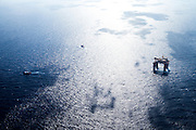 "Deepwater offshore oil platform ""DELTA HOUSE"" being positioned offshore in the Gulf of Mexico by Crowley Maritime Corporation's OCEAN CLASS Tugs. (Aerial Photography by Tim Burdick)"