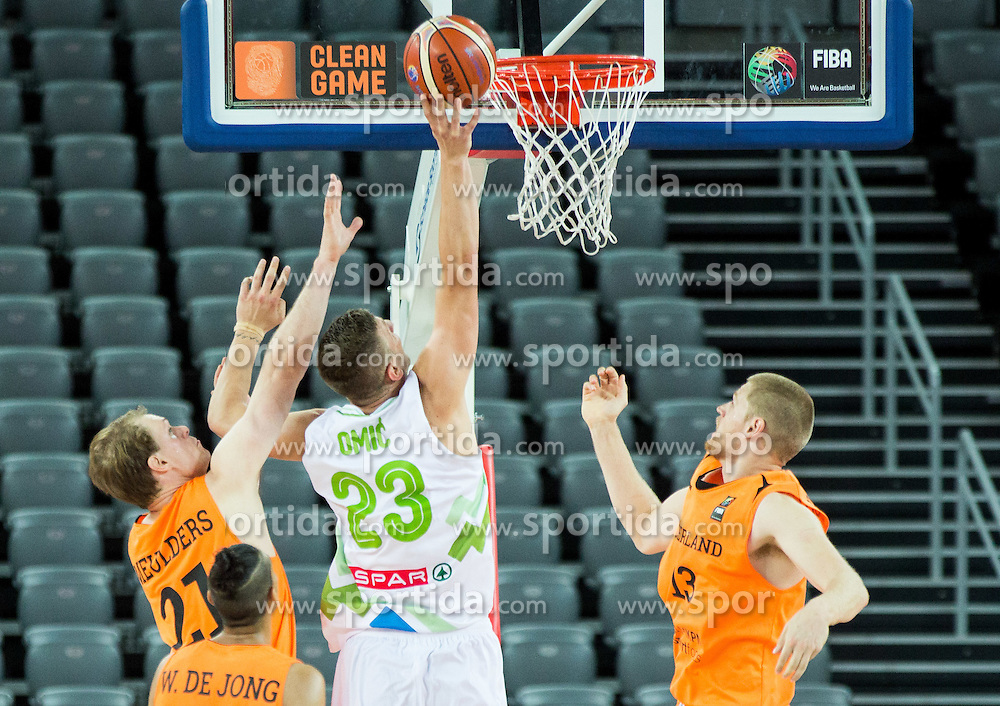 Alen Omic of Slovenia between Robin Smeulders of Netherlands and Henk Norel of Netherlands during basketball match between Slovenia vs Netherlands at Day 4 in Group C of FIBA Europe Eurobasket 2015, on September 8, 2015, in Arena Zagreb, Croatia. Photo by Vid Ponikvar / Sportida