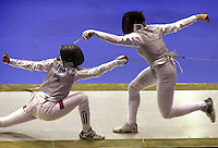 Polish Sylvia Gruchala, left, combats against Russian Joucheva, at the final heat of foil by team for women during the 49th Fencing World Championship celebrated in Havana, Thursday October 9, 2003, Cuba. Russian team won the gold medal. (AP Photo/Cristobal Herrera)