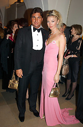 MISS TAMARA BECKWITH and MR GEORGE VERONI at a private dinner to unveil the Van Cleef & Arpels jewellery collection 'Couture' with fashion by Anouska Hempel Couture held at The Banqueting House, Whitehall Palace, London on 8th March 2005.<br />