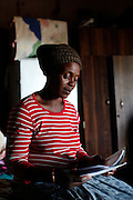 Francina reads the eviction letter she has received. Mother &amp; Daughter Francina and Selina Netshakhuma have lived and worked on a farm near Musina for several years. When the farm was sold the new owner no longer required their services and threatened them with eviction without giving them an alternative place to go. The Legal Resources Centre has assisted them with legal advice and prevented them from becoming homeless. This case illustrates the vulnerability of rural farm workers who have no security of tenure. Near Musina, Limpopo, South Africa.<br />